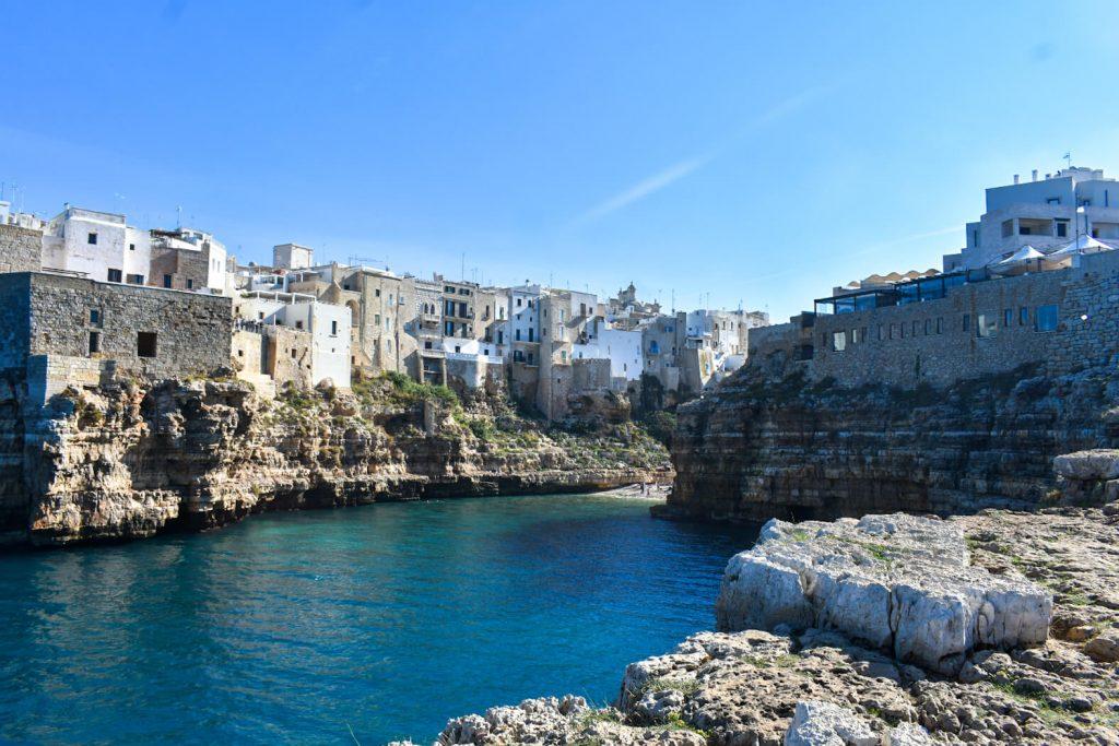 Pebble beach surrounded by cliffs in Polignano a Mare Puglia