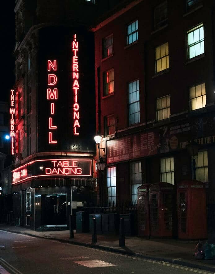 Soho club at night with red light stating 'table dancing'