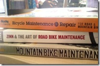 picture of bicycle repair book on top of another
