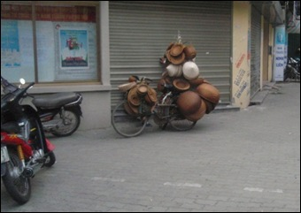 Bicycle in vietnam with hats on it
