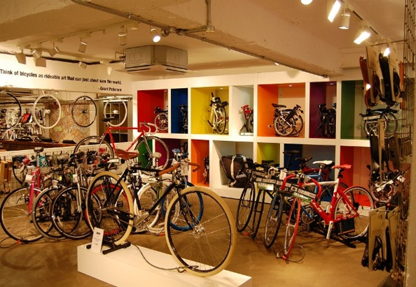 """Flickr photo of new Evans Store - Quote reads: """"Think of bicycles as a rideable art that can just about save the world"""""""