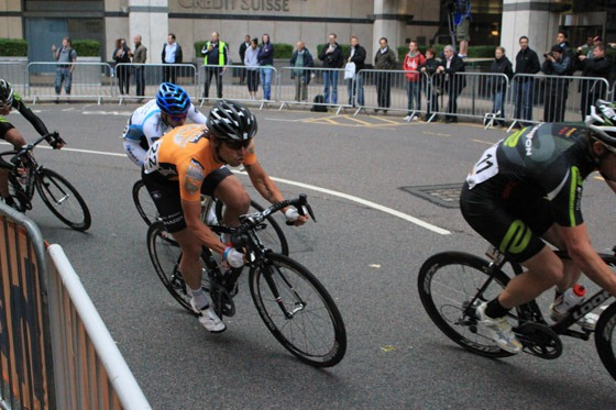 Professional cyclists going at speed around the track