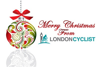 A Christmas ball hangs to the left of the words Merry Christmas from London Cyclist