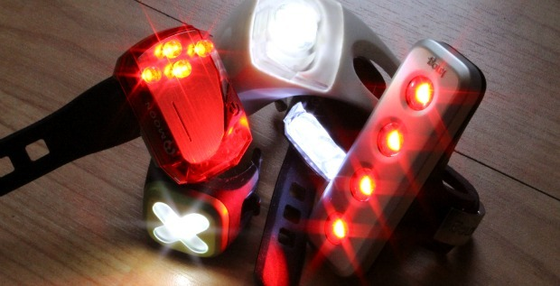 Some of the best bike lights for cycle commuters grouped together on a table