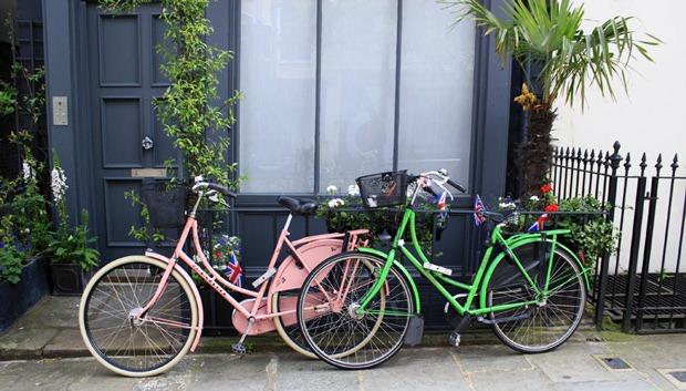 Dutch bikes secured to the railing
