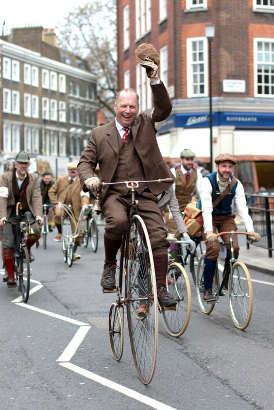 Cyclist waves his hat in the Tweed Run event