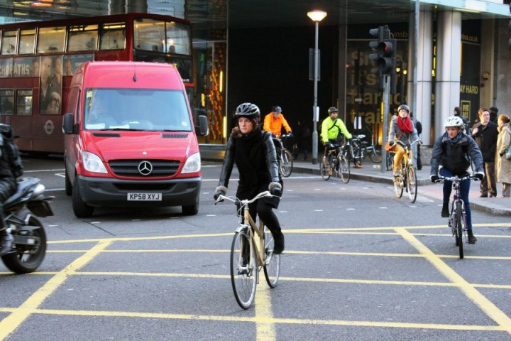 Female cyclists pedalling past