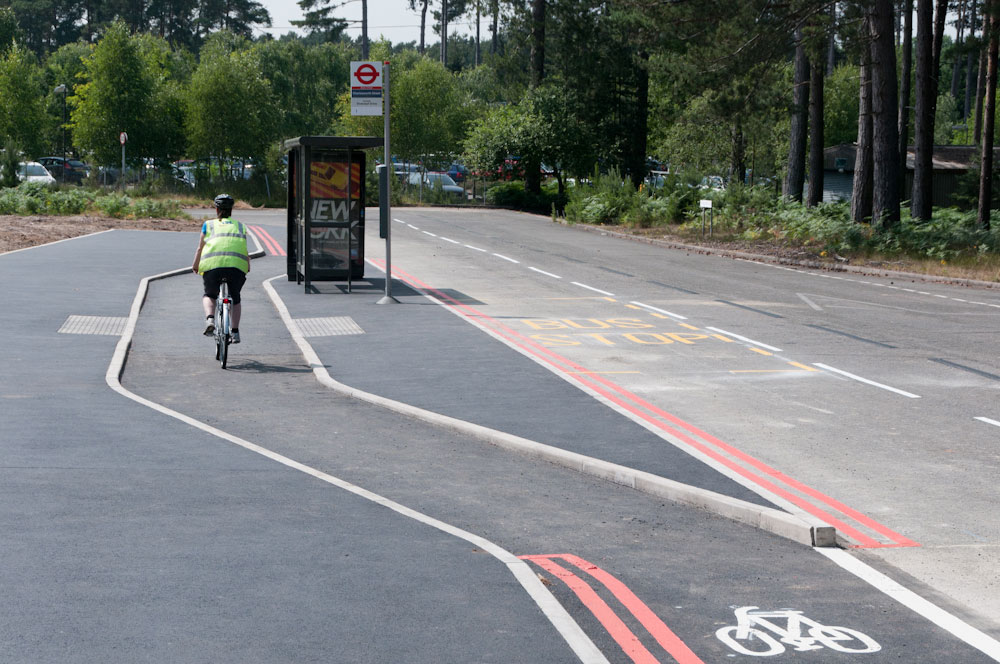 Cyclist riding around a bus stop in TRL testing facility