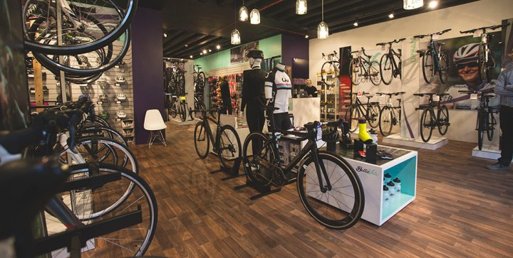 Picture of the inside of Bella Velo bike shop, showing  bikes on display