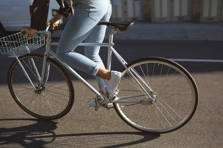 Photograph of woman cycling in Levi's commuter jeans