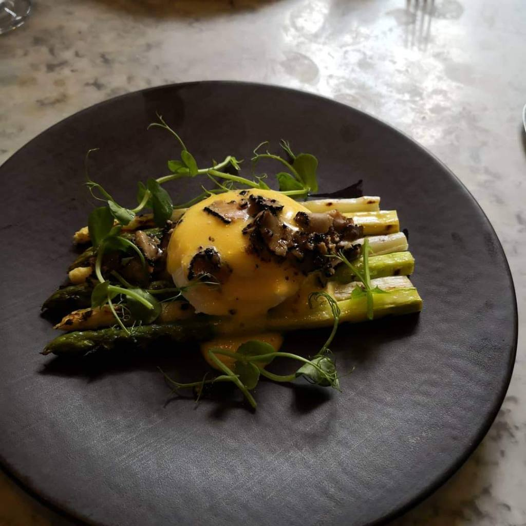 Spring Jungle at Dalloway Terrace grilled asparagus with egg and hollandaise sauce