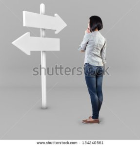 stock-photo-girl-before-a-white-roadsign-in-fear-of-the-unknown-134240561