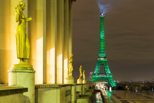 Paris monuments light up green to celebrate climate change
