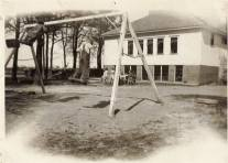 1930's - Kids playing on the swing set