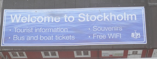 the welcome sign on top of the souvenir building at Stockholm as seen from the ship
