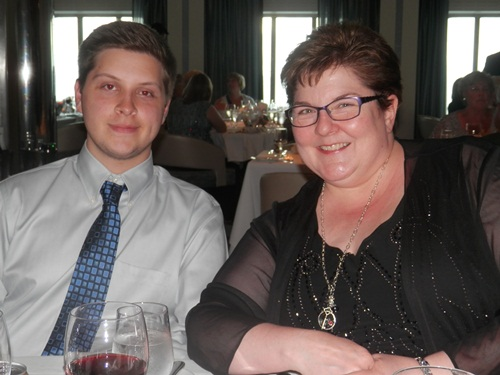 Cyndi Ingle and her son Evan at the formal dinner