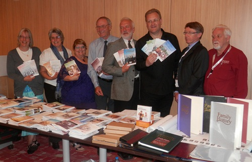 Unlock the Past guide book authors onboard this cruise with their books and the booksellers L-R: Janet Few, Rosemary Kopittke, Helen Smith, Eric Kopittke, Paul Milner, Chris Paton, Tony Beardshaw and Alan Phillips Missing from the photo were Shauna Hicks, and Carol Baxter, both unwell at this time