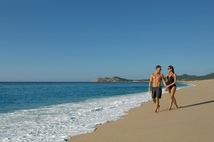 Dreams Los Cabos Suites Golf Resort & Spa - Grounds - Couple on the beach