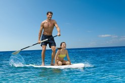 Dreams Las Mareas Costa Rica - Activities - Dad and daughter stand-up paddleboarding