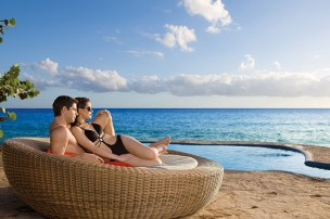 Dreams La Romana Resort & Spa - Grounds - Couples can relax together on daybeds by the pool and beach