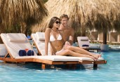 Dreams Palm Beach Punta Cana - Grounds - Guests can enjoy lounge chairs in the main pool