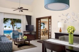 Dreams Palm Beach Punta Cana - Accommodations - The separate living area of the Master Suite featuring a sofa, flat screen TV and furnished balcony