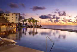Dreams Riviera Cancun Resort & Spa - Activities - Pool at Dusk