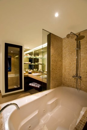 Dreams Palm Beach Punta Cana - Accommodations - The full bathroom of the Deluxe Jacuzzi Tropical View, Preferred Club offers upgraded bath amenities, a double sink, and a Jacuzzi