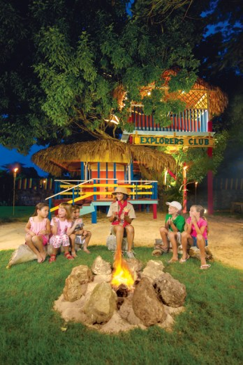 Dreams La Romana Resort & Spa - Activities - Children around a campfire, one of the many activities offered at the Explorer's Club for kids