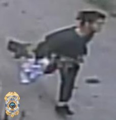 Photo of sexual assault suspect running; side view