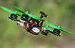 A Drone banking into a turn on the race course at Chisholm Trail's Drone Racing Outpost.