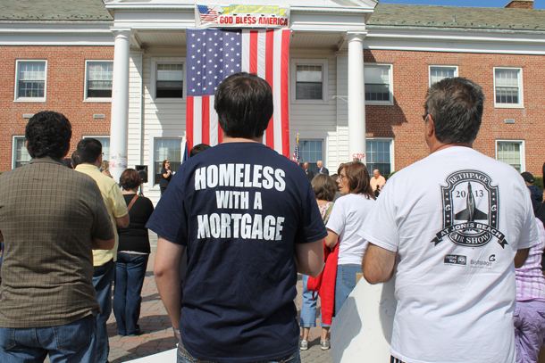 "One Year Later: Dozens of struggling homeowners rallied at Babylon Town Hall Saturday, Sept. 28. Many held signs and donned shirts that declared, ""Homeless With A Mortgage."""