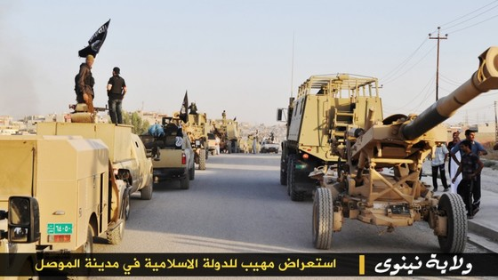 https://i0.wp.com/www.longwarjournal.org/threat-matrix/assets_c/2014/06/ISIS-Mosul-Parade-3-thumb-560x315-3328.jpg
