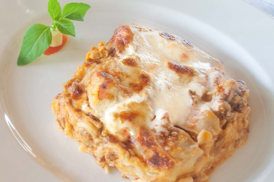Lasagna Bolognese. Layers of homemade flat lasagna noodles baked with alternating layers of Bolognese sauce, béchamel and grated parmesan cheese