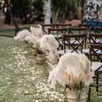 Pampas grass in baskets for the ceremony aisle