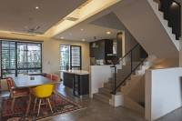 A loft-style house with high ceilings and open spaces ...