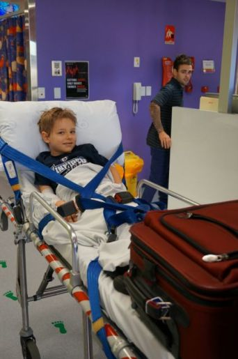 Coming in to Royal Children's Hospital, Sam was happy, with Curious George riding on the stretcher rail.