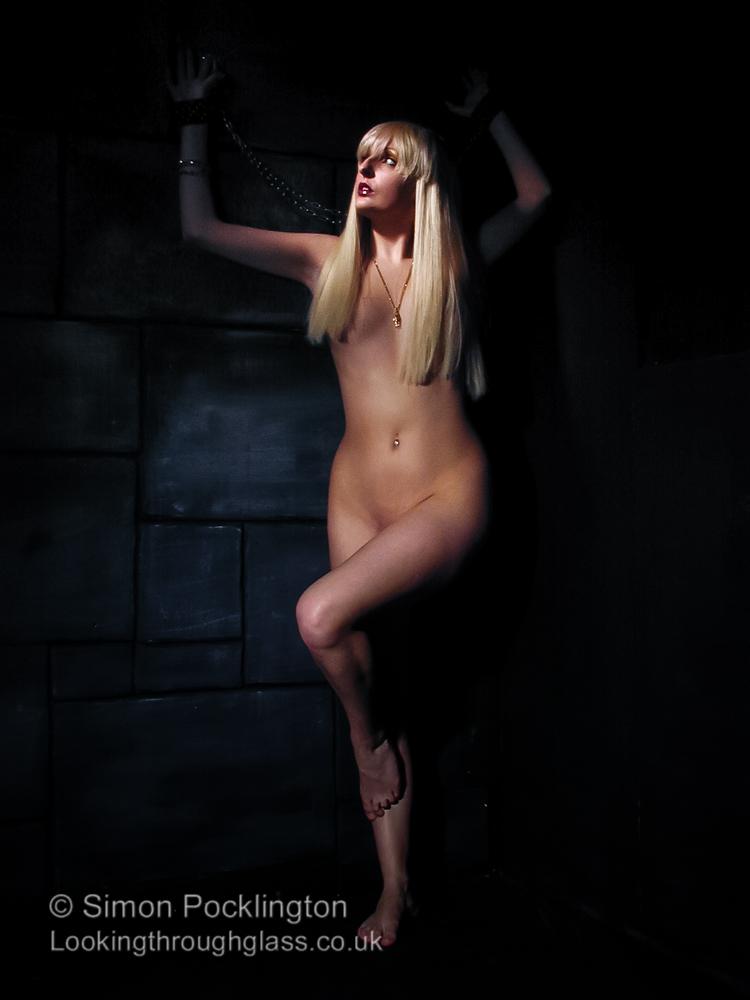 Nude fetish model in bondage
