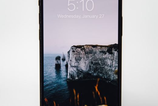 silver iphone 6 displaying rock formation on water