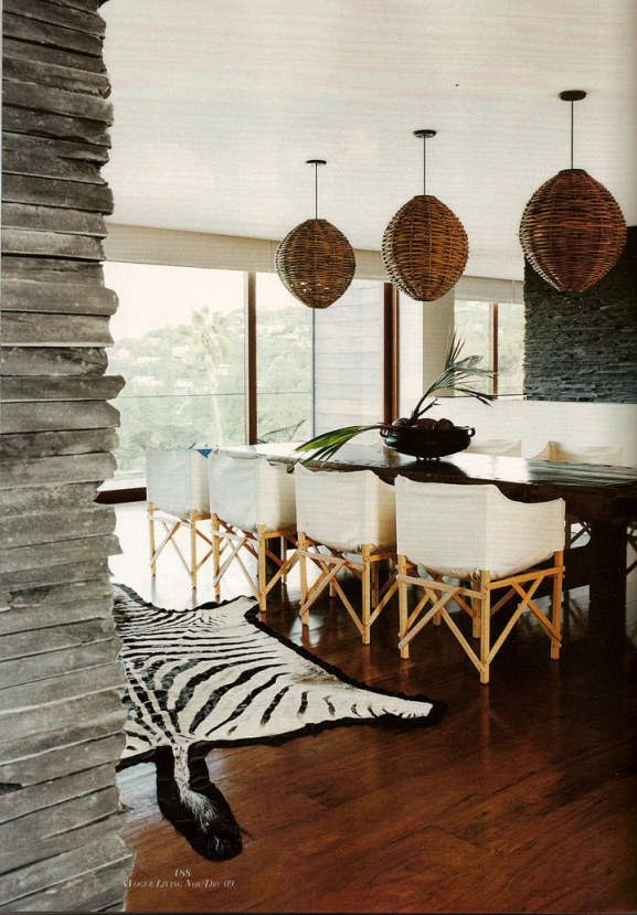 Beautiful zebra skin rug and woven basket lamps in this stylish African inspired dining room