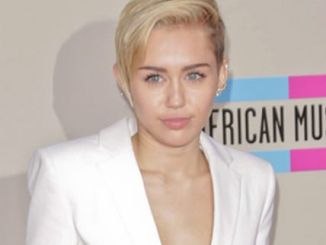 Miley Cyrus - 41st Annual American Music Awards - Arrivals