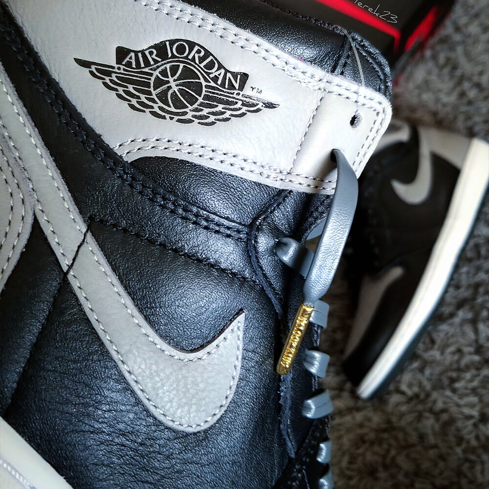 dark grey leather shoe laces with gold tips on jordan shadows
