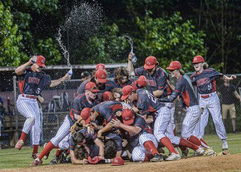 The Independence Patriots celebrate their win over Bluefield as well as their state tournament berth on Thursday in Coal City. (F. Brian Ferguson/Lootpress)