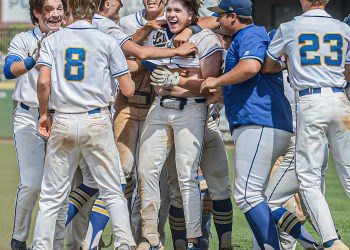 Logan's Konner Lowe, center, is mobbed by his teammates after his game winning hit in the bottom of the 7th against Herbert Hoover. Logan will face North Marion on Saturday in the Class AA State Tournament in Charleston. (F. Brian Ferguson/Lootpress)
