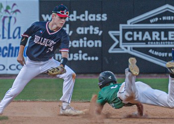 Man shortstop Caleb Blevins waits to put the tag on Charleston Catholic's Evan Sayre during a failed steal attempt during Friday's Class A State Tournament game in Charleston. (F. Brian Ferguson/Lootpress)