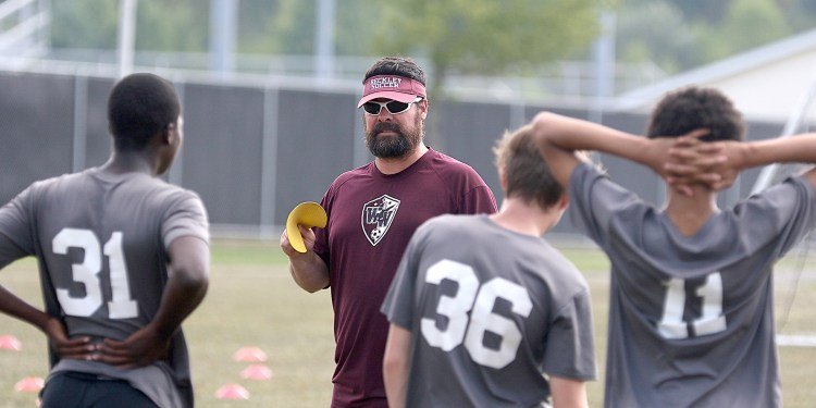 (Brad Davis/For LootPress) Woodrow Wilson head coach Steve Laraba talks with his players at the start of practice Monday afternoon at the YMCA Paul Cline Memorial Soccer Complex.