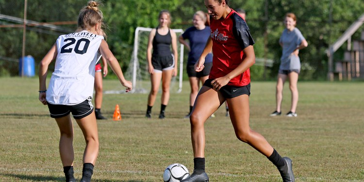 (Brad Davis/For LootPress) Oak Hill players Samiah Lynch, right, and Kerrisyn Feazell compete in one-on-one drills during practice Thursday evening at Collins Park.