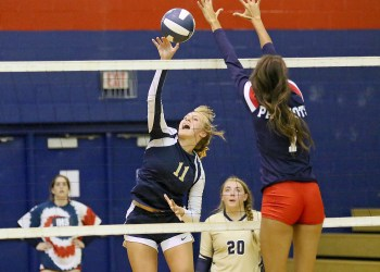 (Brad Davis/For LootPress) Greenbrier West's Kadie O'Dell attacks as Independence's Bella Acord  tries to block Thursday night in Coal City.