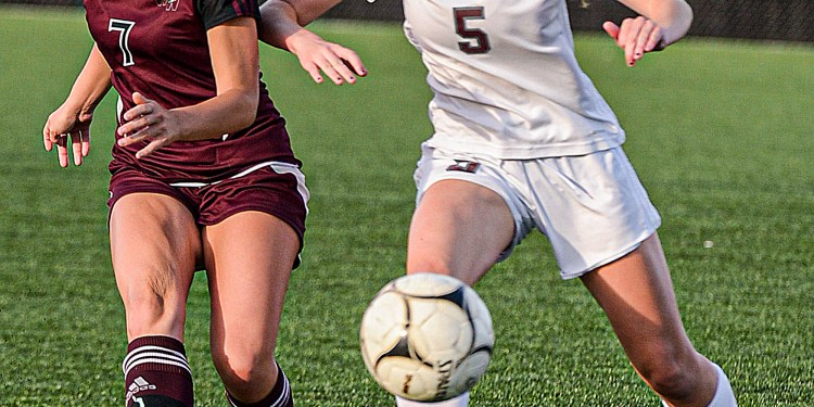 Woodrow Wilson's Sophie Hall, left, and George Washington's Katherine Akers fight for the ball during Thursday action in Beckley. (F. Brian Ferguson/Lootpress)