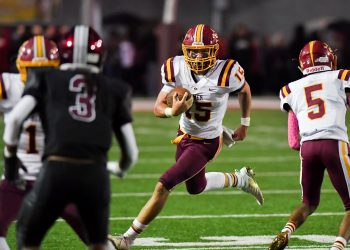 Graham QB Zach Blevins runs out to his right during Friday's 31-6 win over Bluefield at Mitchell Stadium (Greg Barnett/Lootpress)